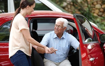 Senior Home Care San Diego Caregiver Assisting Senior Out of Car