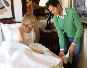 Recovery Home Care Senior San Diego Caregiver Assisting Senior in Bed