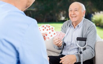 Senior Home Care San Diego Caregiver and Senior Playing Cards Brain Health